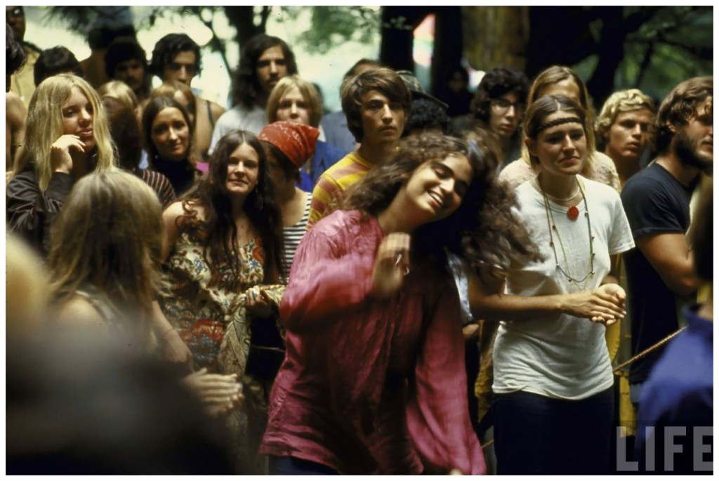psylvia-dressed-in-a-pink-indian-shirt-dancing-in-the-midst-of-the-crowd-during-the-woodstock-music-art-festival-bill-eppridge-1969